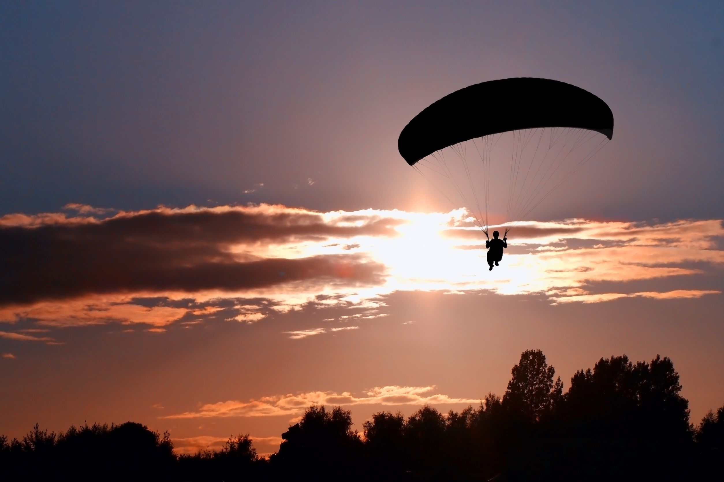 new zealand paraglider sunset 123rf
