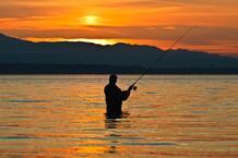 man holding fish 123rf