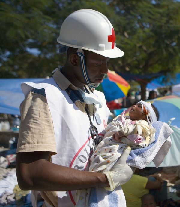 Hatian Aid worker with baby