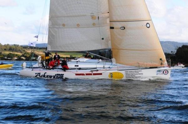 A yacht races in the Three Peaks Races in Tasmania, AU