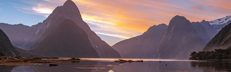 New_Zealand_Mountain_Bay_Sunset_Thinkstock_footer.jpg